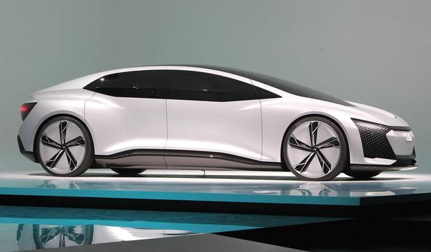 An Audi Aicon Concept car is presented at the Frankfurt Motor Show IAA in Frankfurt am Main, western Germany, on September 12, 2017. According to organisers, around 1,000 exhibitors from 39 countries will showcase their products and services. This year's fair running from September 14 to 24, 2017 will focus on digitization, urban mobility and electric mobility.