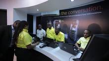 Staff wait for customers at the grand opening of Research In Motion's first official BlackBerry store in Lagos, Nigeria. (Iain Marlow/The Globe and Mail)