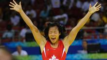 Carol Huynh won Canada's first gold medal of the Beijing Olympics when she defeated Chiharu Icho of Japan in the women's 48 kg freestyle wrestling match. (Fred Lum/The Globe and Mail)