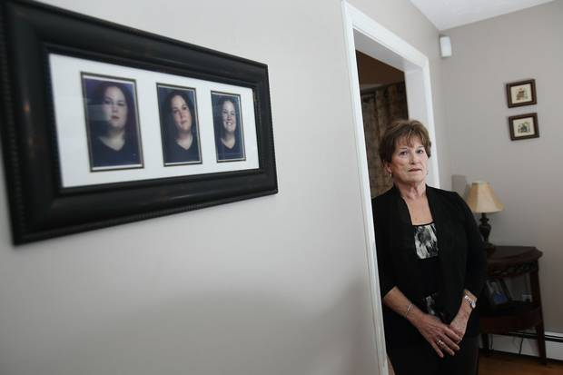 Coralee Smith stands next to portraits of her daughter, Ashley Smith, at her home in Dartmouth, N.S., in December, 2014.