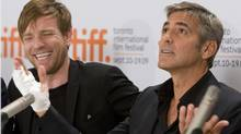 "Ewan McGregor (left) laughs at George Clooney's reaction to a question at the news conference for the movie ""Men Who Stare at Goats."" (FRANK GUNN)"