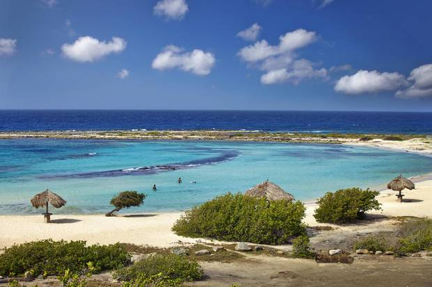 Baby Beach, located on Aruba's southeastern tip, is a stunning and little-known destination, with a crescent of white sand and double coral reef.