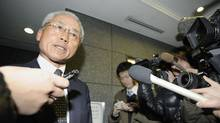 A lawyer for corporate pension fund manager AIJ Investment Advisors Co. speaks with reporters at the building housing the office of the company, after the Financial Services Agency ordered the company to suspend its business for one month earlier in the day, in this photo taken by Kyodo February 24, 2012. (KYODO/REUTERS)