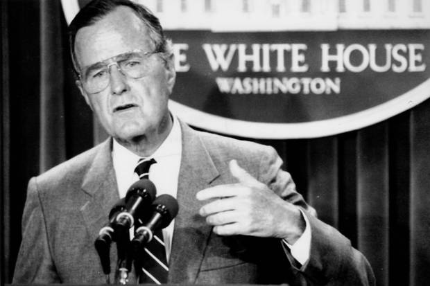 U.S. president George H.W. Bush conducts a press conference at the White House on Aug. 14, 1990.