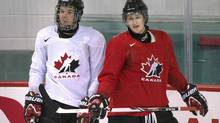 Team Canada hockey prospects Connor McDavid, left, and Nathan MacKinnon chat during Canada's National Junior Team training camp in Brossard, Que., Sunday, August 4, 2013. McDavid scored in Canada's 7-3 exhibition victory over Sweden in Lake Placid, N.Y. on Thursday. (Graham Hughes/THE CANADIAN PRESS)