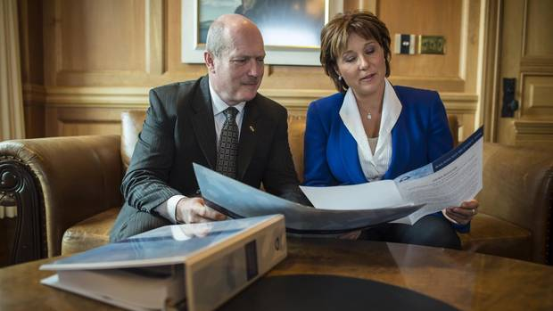 Finance Minister Mike de Jong and Premier Christy Clark look over the budget in the Premier's Victoria office on February 16, 2016, before tabling the budget in the legislature.