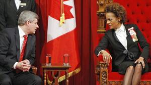 Prime Minister Stephen Harper and Governor-General Michaelle Jean chat before the Speech from the Throne in the Senate chamber on March 3, 2010. (CHRIS WATTIE/REUTERS)