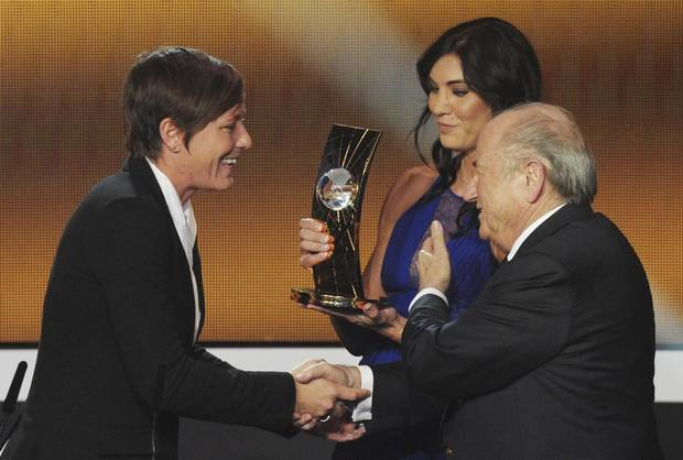 In this Jan. 7, 2013, file photo, Abby Wambach is presented the FIFA Women's World Player of the Year award by Hope Solo and FIFA President Sepp Blatter.