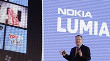 Nokia's President and CEO Stephen Elop gestures as he speaks during a news conference for the launch of the new Nokia Lumia products in Beijing, March 28, 2012. (ZHEYANG SOOHOO/REUTERS)