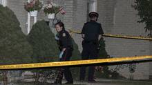 Toronto police have one suspect in custody after a triple homicide in Etobicoke Monday, July 15, 2013. (John Hanley for The Globe and Mail)