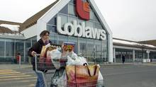 Caroline Gagnon leaves a Loblaws store in St. Eustache, Que. (Ryan Remiorz)