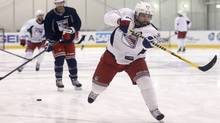 New York Rangers right wing Martin St. Louis, right, takes a shot on goal during a team practice at the Rangers training facility in Greenburgh, N.Y., Sunday, June 1, 2014. (Associated Press)