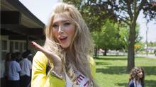 Transgendered beauty queen Jenna Talackova gestures outside the school as Miss Universe Canada contestants visit St. John Vianney Catholic School in Toronto on Tuesday May 15, 2012. (Chris Young/THE CANADIAN PRESS/Chris Young/THE CANADIAN PRESS)