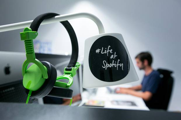 A pair of audio headphones hang from a lamp shade inside the offices music streaming company Spotify Ltd. in Berlin on Friday, June 17, 2016.