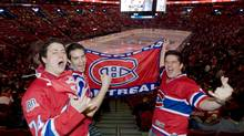 Montreal Canadiens' fans, from left, Bruno Paradise, Felix Pilote and Pierre-Luc Lachapelle cheer for their team at the Bell Centre in Montreal, Wednesday, May 12, 2010 prior to game 7 of an NHL hockey Eastern Conference semifinal series between the Canadiens and the Pittsburg Penguins. (Graham Hughes/THE CANADIAN PRESS)