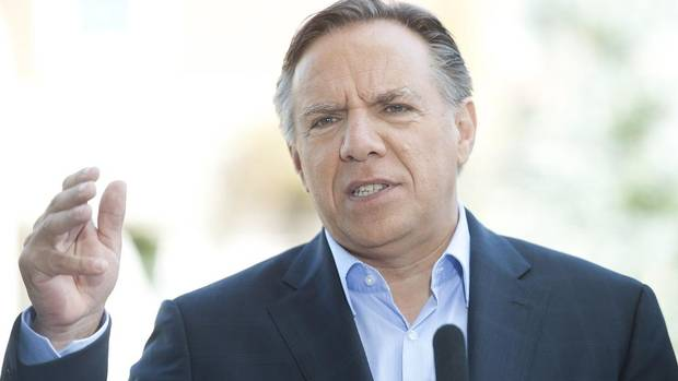 Coalition Avenir Quebec leader Francois Legault speaks to reporters during an election campaign stop in Becancour, Que., Sunday September 2, 2012.