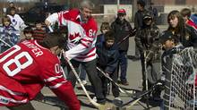 Stephen Harper plays ball hockey with a group of youngsters in Ottawa on Sunday, April 3, 2011 (Sean Kilpatrick)
