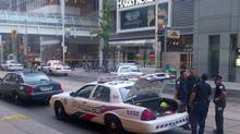 Police set up outside the Eaton Centre shopping mall in Toronto, Saturday, June 2, 2012. Shots were fired at Toronto's downtown Eaton's Centre Saturday evening and at least two people were taken out on stretchers, local media outlets were reporting. (John Chidley-Hill/THE CANADIAN PRESS)