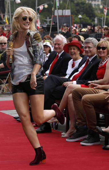 Prime Minister Stephen Harper smiles and keeps his eyes firmly on the bottom line as Emily Haines of Metric performs at the Canada Day celebrations in Ottawa on Monday. (Chris Wattie/Reuters)