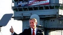 Former President Bush flashes a thumbs-up after declaring the end of major combat in Iraq aboard a U.S. aircraft carrier in 2003. He now says declaring mission accomplished was a mistake. (AP)