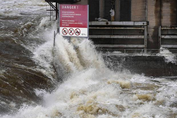 May 6: The Ottawa River crashes past a warning sign at the Chaudière Falls in Ottawa.