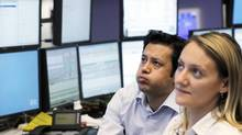 Traders work at their desks at the Frankfurt stock exchange June 29, 2012. (ALEX DOMANSKI/REUTERS)