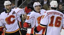 Calgary Flames' Mike Cammalleri (2nd L) celebrates with teammates after scoring against the Los Angeles Kings during the third period of their NHL game in Los Angeles, February 18, 2012. REUTERS/Lucy Nicholson (Lucy Nicholson/Reuters)