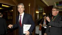 Bill Ackman, left, CEO of hedge fund Pershing Square, leaves a board meeting following the annual meeting of Canadian Pacific Railway in Calgary, Thursday, May 17, 2012. (Jeff McIntosh/The Canadian Press/Jeff McIntosh/The Canadian Press)