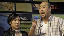 Esther Jun as Janet, Paul Lee as Appa in Kim's Convenience.