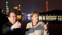 Chinese Premier Wen Jiabao and German Chancellor Angela Merkel stroll along a bank of the River Pearl in Guangzhou, Feb. 3, 2012. China is willing to help the euro zone, but like Germany, is taking a cautious stance. (Steffen Kugler/Reuters/Steffen Kugler/Reuters)