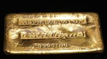 A 999.9 fine gold 100 troy ounce Engelhard gold bar. (SHANNON STAPLETON/SHANNON STAPLETON/REUTERS)