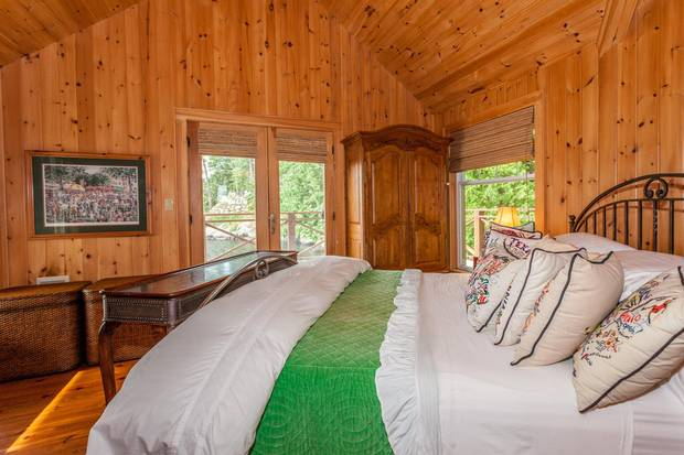 The boathouse quarters provide the owners with privacy when extended family stays in the cottage.