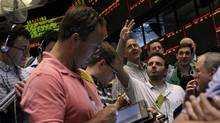 Traders work the crude oil options pit at the New York Mercantile Exchange Tuesday, June 19, 2012 in New York. The price of oil edged higher above $83 a barrel Tuesday as traders closely watched talks between Iran and six world powers over the Middle Eastern country's nuclear program and developments in the eurozone debt crisis. (Mary Altaffer/AP)