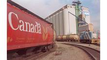 Saskatchewan and Alberta are calling for tougher federal laws for the grain transportation system after a bottleneck that has left crops sitting in bins across the Prairies. (Chuck Stoody/CP)