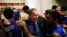Florida Gulf Coast players celebrate with their coach Andy Enfield in the team's locker room after winning a third-round game against San Diego State in the NCAA college basketball tournament, Sunday, March 24, 2013, in Philadelphia. Florida Gulf Coast won 81-71. (Scott McIntyre/AP)