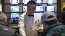 A dealer at the River Rock Casino in Richmond, B.C., on Feb. 22, 2013. (John Lehmann/The Globe and Mail)