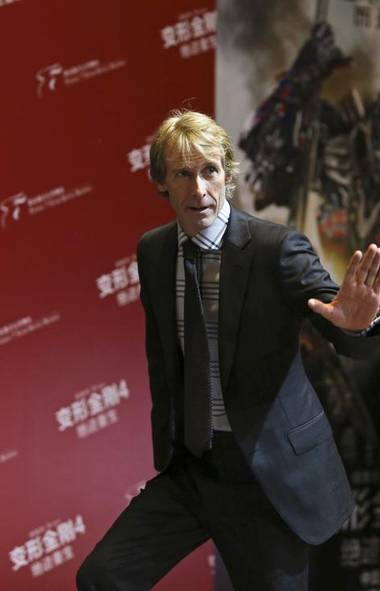 Hang onto your hat because we're all over the map this week, starting with a stop in Beijing, where director Michael Bay calmed the crowd at the Transformers: Age of Extinction premiere by explaining that the star of his movie was simply a big dumb hunk of machinery (named Mark Wahlberg) (REUTERS)