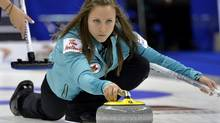 Skip Rachel Homan throws a rock against Team Jones during draw 11 at the Roar of the Rings Canadian Olympic Curling Trials in Winnipeg, December 4, 2013. (FRED GREENSLADE/REUTERS)