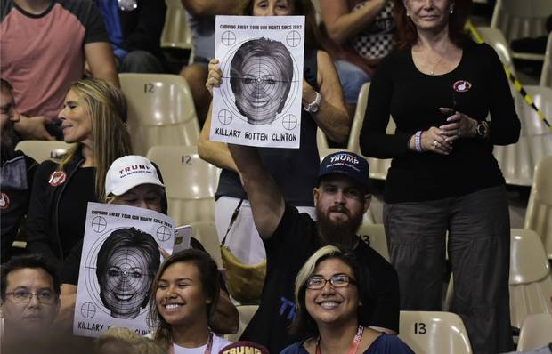 Supporters hold a poster of Hillary Clinton with a target over it at a Trump rally in Sarasota, Fla., on Nov. 7.