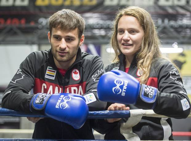 Canadian Olympic Boxing team members Arthur Biyarslanov (64 kg) and Ariane Fortin (75kg) pose for photos after being introduced to the media, in Montreal on Thursday, July 14, 2016. Canada is sending only three boxers to the 2016 Olympics, but Arthur Byarslanov, Mandy Bujold and Ariane Fortin are all medal contenders.