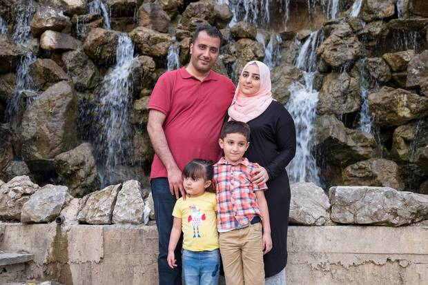 Father Waleed and mother Duaa are shown with their children Khaled, 6, and Lana, 3. The family is now living in Istanbul while waiting for their refugee applications to be processed.