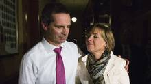 Ontario Premier Dalton McGuinty walks with his wife Terri after making an announcement to resign from the leadership of the Ontario provincial Liberal party at Queen's Park in Toronto, October 15, 2012.  (MARK BLINCH/REUTERS)