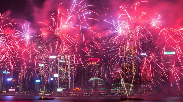 Fireworks explode over Victoria Harbour during Lunar New Year celebrations in Hong Kong on February 9, 2016.