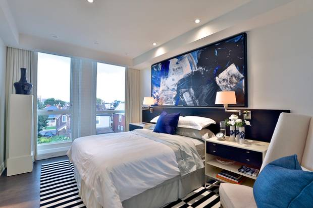 The master suite boasts views over the surrounding rooftops.