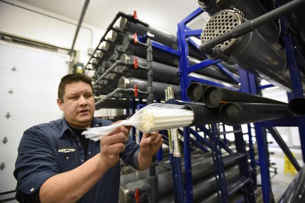 John Owl, an infrastructure technician with the Serpent River First Nation, displays the filters (membranes) used to treat water at a plant near Sudbury, Ont.