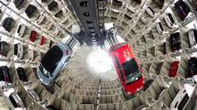 A New Beetle Cabrio, left, and a Golf VII photographed in the elevators of the storage of German Volkswagen car producer in Wolfsburg , northern Germany, Thursday Match 14, 2013. (Sebastian Kahnert/AP)