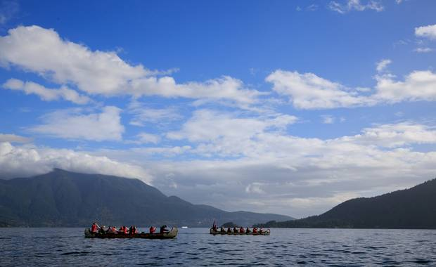 PMMembers of the Canada C3 expedition canoe through Howe Sound on October 21, 2017.