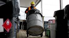 A city worker wheels a steel drum containing old pots of household paint at the household hazardous waste depot at Commissioners St. transfer station in Toronto on Wednesday February 1, 2012.Photo by Chris Young for The Globe and Mail (Chris Young/Chris Young for The Globe and Ma)