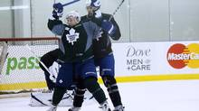Toronto Maple Leafs forward Leo Komarov, left, battles with teammate and captain Dion Phaneuf during training camp this week. Komarov will be on a line with Nazem Kadri this season. The Leafs open their season against the Canadiens in Montreal on Saturday night. (Michelle Siu/THE CANADIAN PRESS)