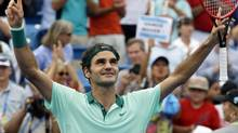 Roger Federer, from Switzerland, celebrates after defeating David Ferrer, from Spain, 6-3, 1-6, 6-2, in a final match at the Western and Southern Open tennis tournament, Sunday, Aug. 17, 2014, in Mason, Ohio. (Al Behrman/AP)